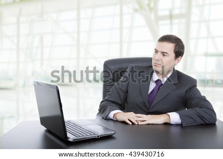 young business man working with is laptop at the office - stock photo