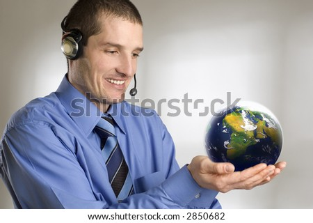 young business men holding planet earth close up - stock photo