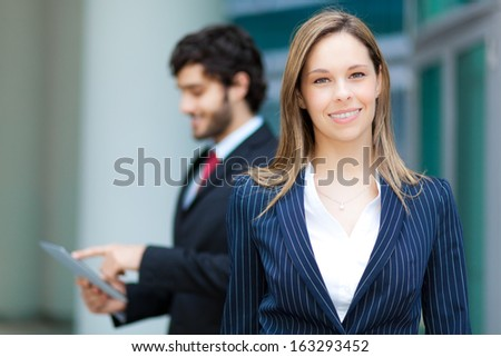 Young business partners in urban setting - stock photo