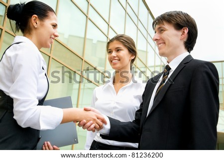 Young business partners making an agreement - stock photo