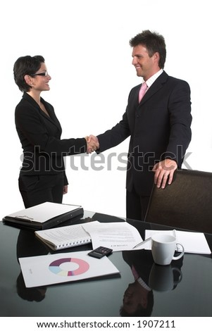 Young business people are shaking hands after a business deal. Isolated version.
