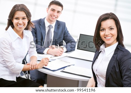 Young business people are working together at office - stock photo