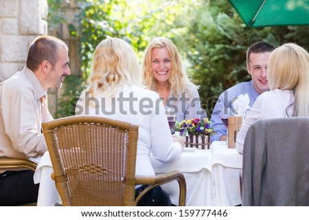 young business people at the lunch restaurant discussing - stock photo