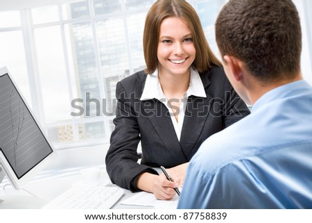 Young business people discussing a new project - stock photo
