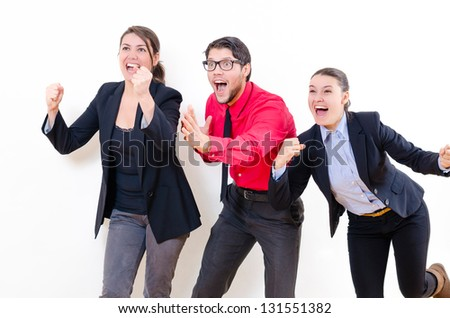 Young business people enjoying their success - stock photo