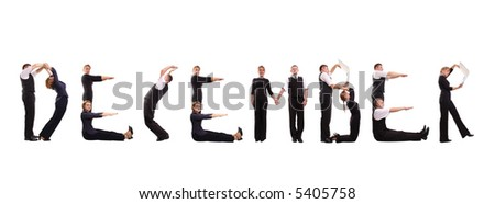 Young business people forming December word over white - business calendar concept - stock photo