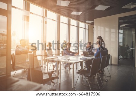 bright office. young business people group have meeting and working in modern bright office indoor
