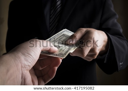 young business people hands and money - stock photo