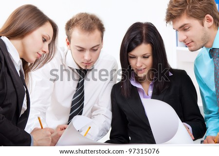 young business people happy smile talking, businessmen and businesswomen looking at plans at desk office discussing during meeting, briefing or working day, businesspeople paperwork - stock photo