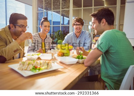 Young business people having lunch together - stock photo