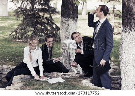 Young business people in a city park