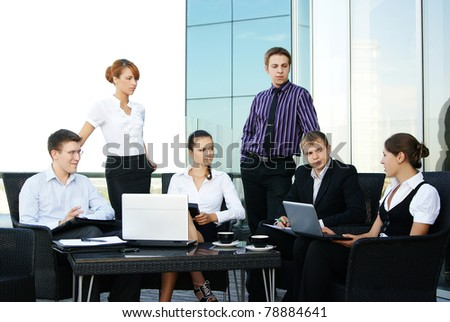 Young business people in office - stock photo