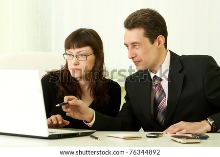 Young business people in the office - stock photo