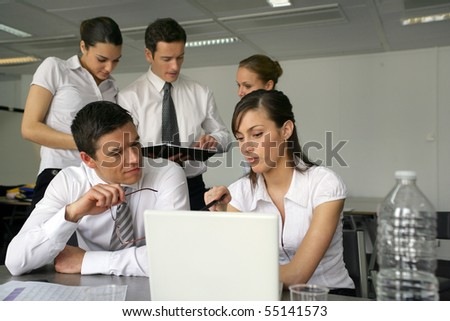 Young business people meeting with laptop computer and documents - stock photo