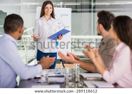 Young business people sitting at meeting room and listening speaker. - stock photo