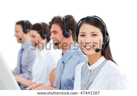 Young business people talking on headset in a call center - stock photo