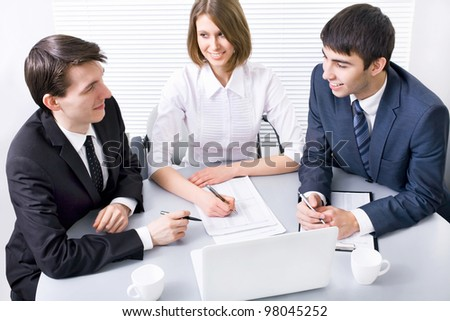 Young business people working at meeting - stock photo