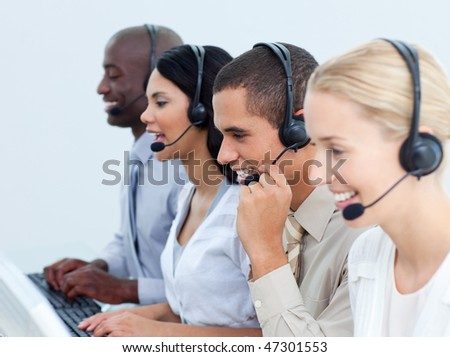 Young business people working in a call center in the office - stock photo
