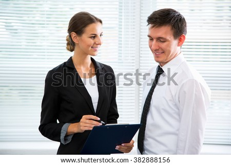 Young business people working in an office - stock photo