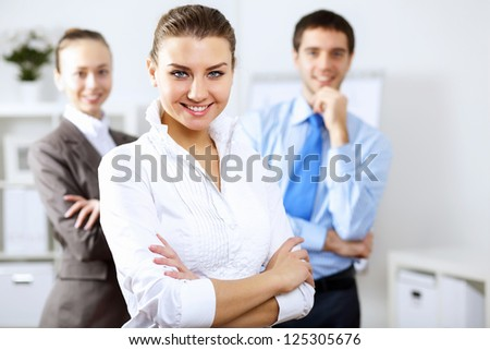 Young business people working together as a team in the office - stock photo