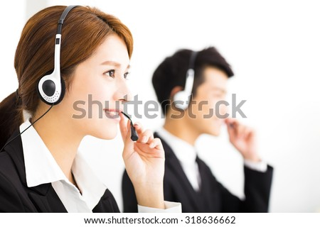 young business people working with headset in office - stock photo