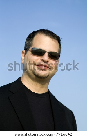Young Business Professional Smiling with Sunglasses - stock photo