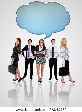 Young business team and text bubble - stock photo