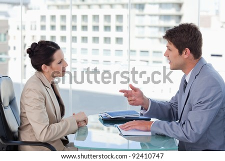 Young business team during a brainstorming in a meeting room - stock photo