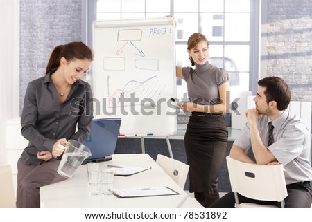 Young business team having workshop, working together, planning presentation, smiling.? - stock photo