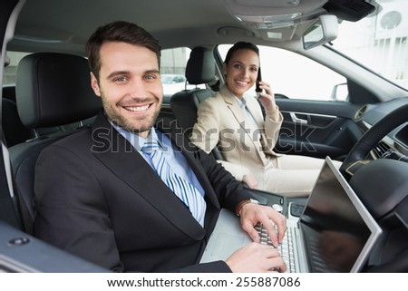 Young business team working together in the car