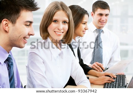 Young business woman and her team - stock photo