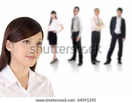 Young business woman and her team over white background. - stock photo