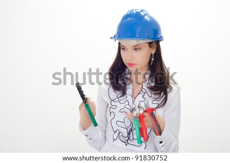 Young business woman chooses the proper tool - stock photo