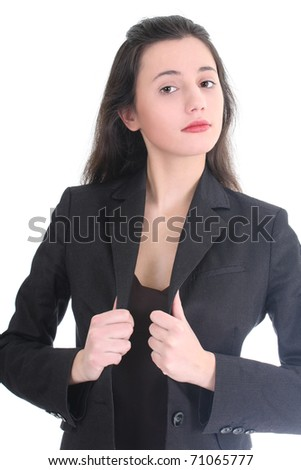 Young business woman correcting her suit over white - stock photo
