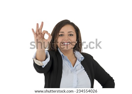 Young business woman doing an ok symbol against a white background - stock photo