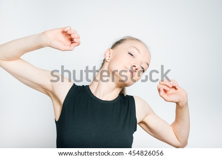 young business woman doing exercises, isolated on a gray background