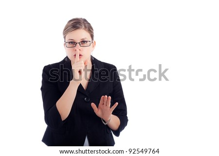 Young business woman gesturing silence sign, isolated on white background. - stock photo