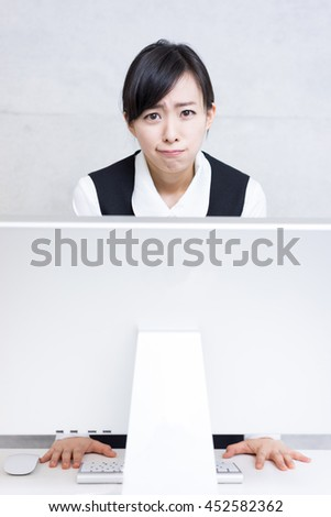 young business woman getting angry at office - stock photo