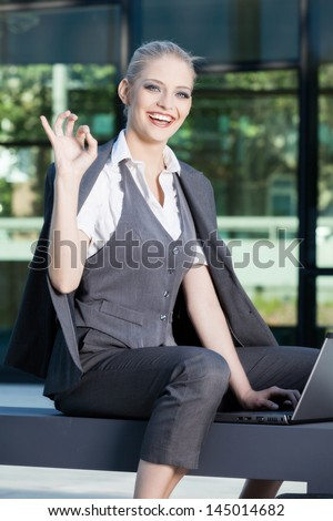 Young business woman give you an Ok sign - stock photo