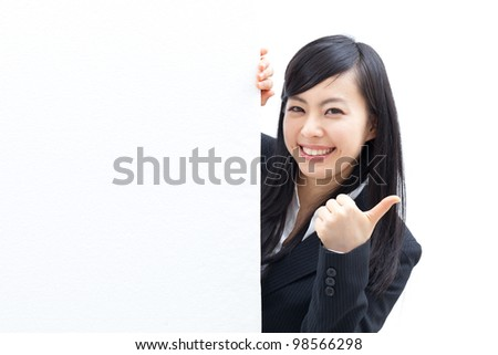 young business woman giving thumbs up with blank billboard, isolated on white background