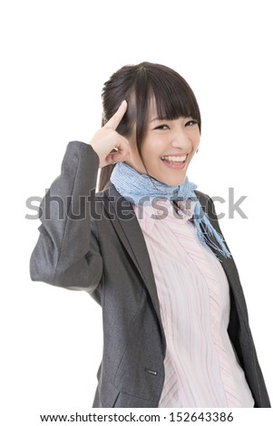 Young business woman has an idea, pointing with finger on her head. Half length portrait. Isolated on the white background. - stock photo
