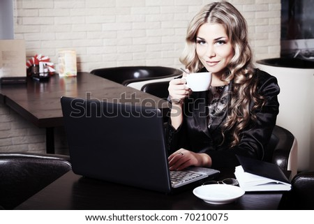 Young business woman having a break at a caf - stock photo