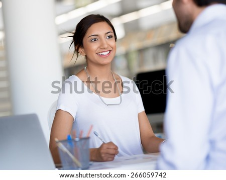 Young business woman having conversation with her collegue - stock photo