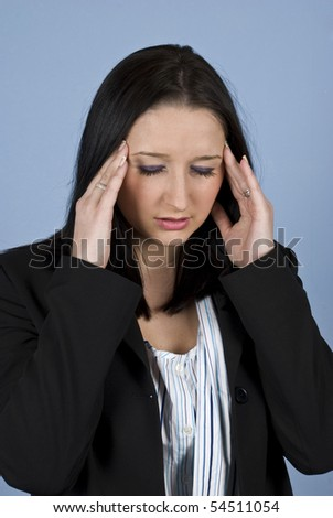 Young business woman having problems or a headache and holding hands to head - stock photo