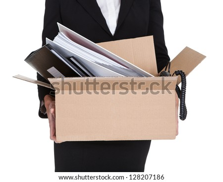 Young Business Woman Holding A Box Of Documents. Isolated On White - stock photo