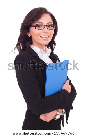 young business woman holding a clipboard with both her hands and smiling to the camera. on white background - stock photo