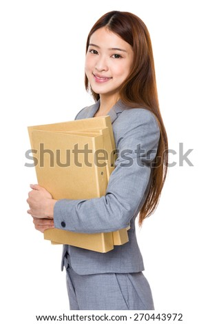 Young business woman holding a report - stock photo