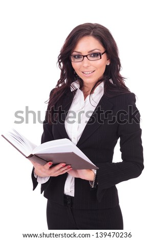 young business woman holding an opened book in her hands and smiling to the camera. on white background - stock photo