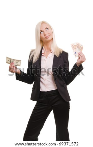 Young business woman holding euro in one hand and dollars in another