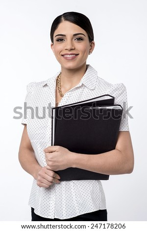 Young business woman holding folder over white